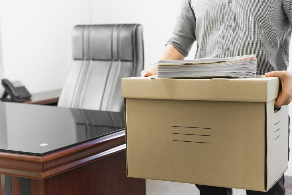 Upset Employee Packing Belongings In Box, Frustrated Stressed Ma